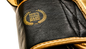 Genuine premium leather handmade sign badge on boxing gloves. Royalty Free Stock Photo