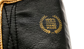 Genuine premium leather handmade sign badge on boxing gloves. Stock Photo