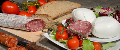 Genuine product. Genuine salami and wheat bread Royalty Free Stock Photography
