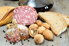 Genuine salami. Table with genuine products of Italian salami nuts and whole wheat bread stock images