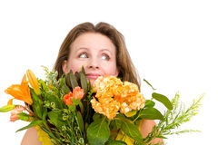 Genuinely Happy Woman Behind the Flower Bouquet Looking up and E Royalty Free Stock Photo