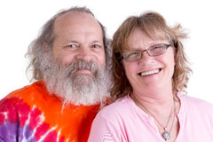 Genuinly Happy Baby Boomer Couple Looking at you Smiling Royalty Free Stock Image