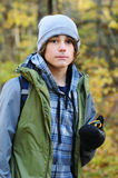 Geo caching. Teen boy hiking with a gps unit while geo caching Stock Image