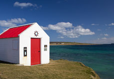 Small building by ocean Stock Images