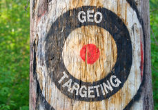 Geo Targeting - tree with target. In the forest Stock Photo