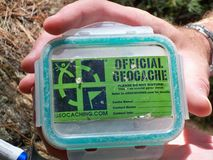 Geocache Container. Small geocaching container that contains smaller exchange items Stock Photo