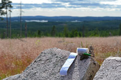 Geocache in wilderness. A geocache has been found in the Swedish wilderness Stock Photo