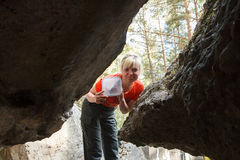 Geocacher finding geocache Stock Image