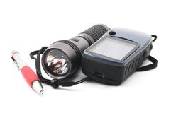 Geocaching. Still life with gps and flashlight isolated on white background Royalty Free Stock Image