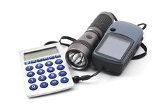 Geocaching. Still life with gps and flashlight isolated on white background Royalty Free Stock Photography