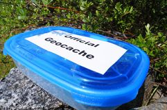 Geocaching. Concept with cache box in nature Royalty Free Stock Images