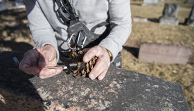 Geocaching and finding a Cache. An active senior man Geocaching and finding a Cache Royalty Free Stock Photography