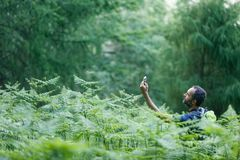 Geocaching. Hiker searching way to cache using global positioning device Royalty Free Stock Photography