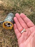 Geocaching items and adult hand closeup Royalty Free Stock Images