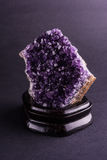 Geode da ametista no fundo preto Fotos de Stock Royalty Free