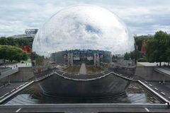 Geode Paris. Game of reflections of a sphere of mirrors Stock Photo