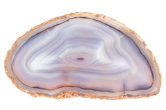 Geode slice. Thin slice of agate geodes with concentric layers isolated over a white background Royalty Free Stock Photography