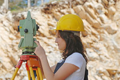 Geodesic. Woman working with geodesic measuring tool Royalty Free Stock Photo