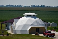 Geodesic Dome. This is a Summer picture of a Geodesic Dome house located in southern Illinois. The design was patented in 1951 by Buckminster Fuller, his goal stock photo