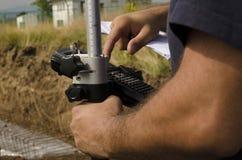 Geodesist fonctionnant avec des généralistes Photo libre de droits