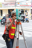 Geodesist making geodetic survey with Altometer Royalty Free Stock Image