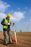 Geodesist measure land look construction plan Stock Photo