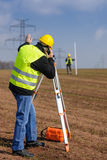 Geodesist measure land speak transmitter Royalty Free Stock Photography
