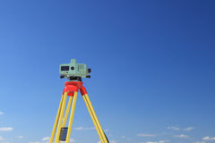 Geodesist taking measurement. Builder's level - construction site by theodolite level transit equipment Royalty Free Stock Photography