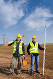 Geodesist two man equipment on construction site Stock Images