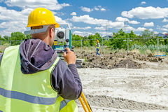 Geodesist is working with total station on a building site. Civi Stock Images