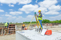 Geodesist is working with total station on a building site. Civi Royalty Free Stock Image