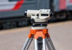 Geodetic equipment optical level mounted on tripod Stock Photos