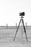 Geodetic instrument on the airfield. Vertical frame. Black and w. Geodetic device at the airport. Surveying instruments. Geodetic instruments on the airfield Royalty Free Stock Photo