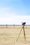 Geodetic instrument on the airfield. Vertical frame. Geodetic device at the airport. Surveying instruments. Geodetic instruments on the airfield Stock Image