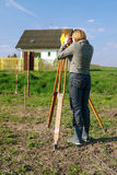 Geodetic survey. Female geodesist performing geodetic survey using altometer royalty free stock photography