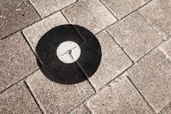 Geodetic survey marker set in a pavement. royalty free stock images