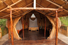Geodome wood and thatch camping hut. A geodesic dome made of wood, grasses, and thatch used as a room for guests royalty free stock photography