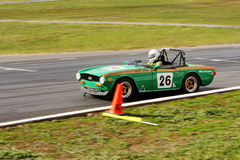 Geoff Byrne in a 1969 Triumph TR6 on the front straight at Winton Stock Photos