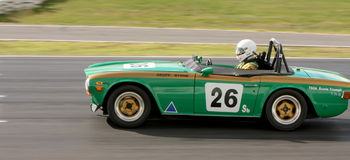 Geoff Byrne in a 1969 Triumph TR6 on the front straight at Winton Royalty Free Stock Image