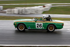 Geoff Byrne in a 1969 Triumph TR6 on the front straight at Winton Royalty Free Stock Photo