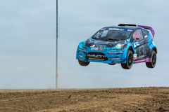 Geoff Sykes rally driver jumps. San Pedro, CA - September 20, 2014:Geoff Sykes rally driver jumps at the Red Bull GRC Global Rallycross at the Port of Los Royalty Free Stock Images