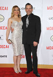 Geoff Zanelli. LOS ANGELES, CA - JANUARY 21, 2015: Composer Geoff Zanelli & wife at the Los Angeles premiere of his movie Mortdecai at the TCL Chinese Theatre Stock Photography