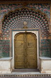 Geogous door in City Palace, Jaipur. City Palace, Jaipur, which includes the Chandra Mahal and Mubarak Mahal palaces and other buildings, is a palace complex in royalty free stock photos