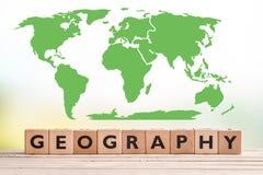 Geografiezeichen mit einer Weltkarte stockfoto