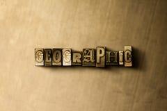 GEOGRAFISKT - närbild av det typsatta ordet för grungy tappning på metallbakgrunden royaltyfri illustrationer