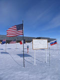 Geographic and Ceremonial South Pole. The Geographic South Pole is marked with a brass marker designed and manufactured by the staff of the South Pole Amundsen Royalty Free Stock Photography