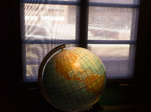 Geographic Globe in the dark room against a window Stock Photography