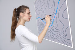 Geographic information systems concept, woman scientist working with futuristic GIS interface on a transparent screen. Royalty Free Stock Photos