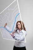 Geographic information systems concept, woman scientist working with futuristic GIS interface on a transparent screen. Stock Image