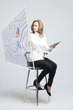 Geographic information systems concept, woman scientist working with futuristic GIS interface on a transparent screen. Stock Photo